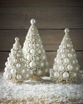"Ivory Bauble Trees Trio. Bottle-brush trees with silver hued plastic balls.  Glitter accents.  9"", 11"" and 13"".  $93.75/set of 3 at Horchow.com"