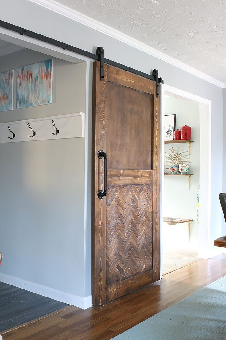DIY Herringbone Barn Door.  It is the perfect way to tie in a little more warmth into this space and to include wood elements.  Bower Power Blog