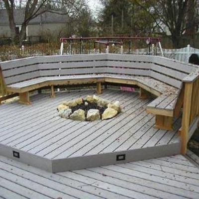 This multi-level Timbertech deck was constructed with a built in gas fire-pit. We controlled the heating to avoid problems with the synthetic decking. Remember composites are manufactured with plastics and wood so control of temperatures were vital. Note the Cedar railings with a back support and the low voltage riser lights. Great place to hang out!