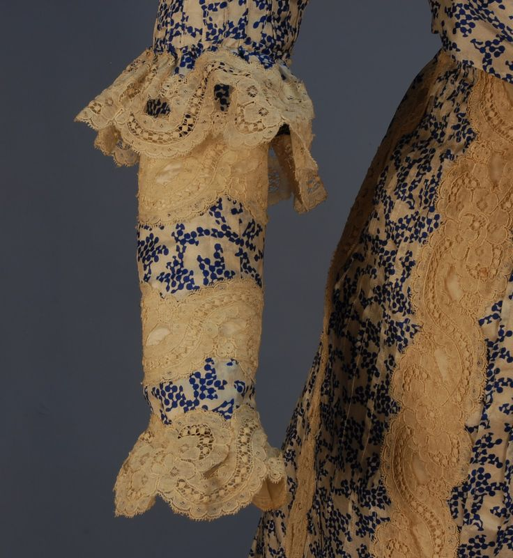 PRINTED SILK HIGH NECK GOWN, c. 1902. 2-piece with blue and white abstract printed and tucked silk panels with bands of scrolling fl...