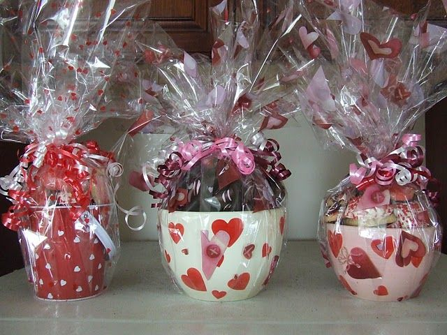 cookies and treats inside decorated bowls & pails wrapped with cellophane. Cute!