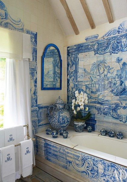 In the bathroom, a panel of circa-1730 Dutch scenic tiles decorates the wall above a Victorian tub   archdigest.com
