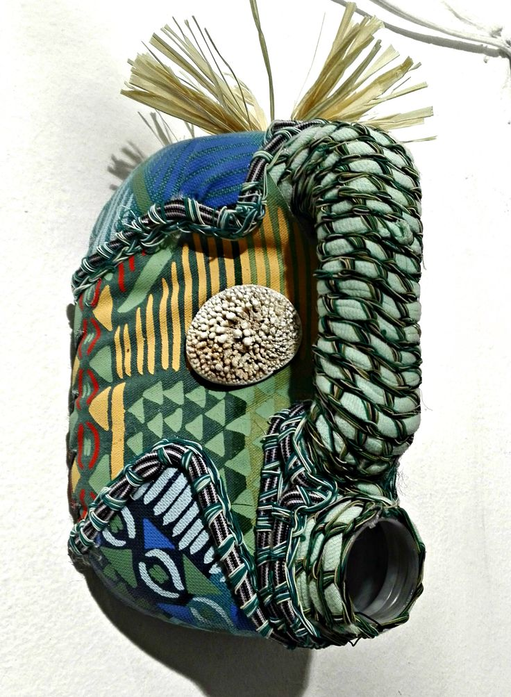 a contemporary take on the African mask, hand painted textile shells crocheted braids- re cycled jerrycan