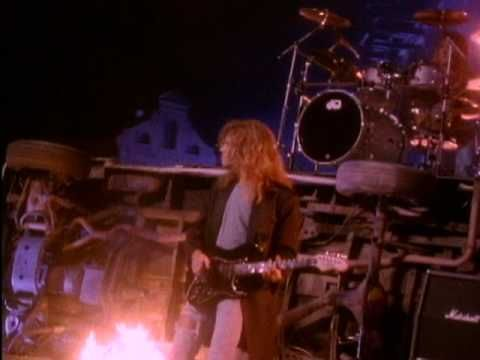 The 80's big hair rocker in me LOVES this song. The Jason Bonham Band- Wait For You.