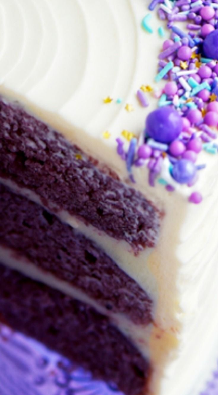 Purple Velvet Cake with Cream Cheese Frosting ~ Moist purple velvet cake filled and frosted with classic cream cheese frosting and topped with a medley of sprinkles.