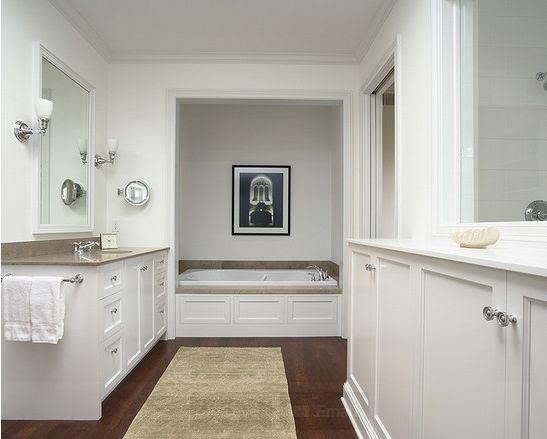 white cabinets dark brown floor wood floor bathroomin