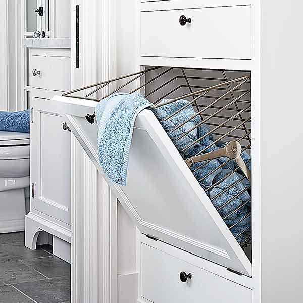 bath and laundry after remodel with hamper insert in linen closet