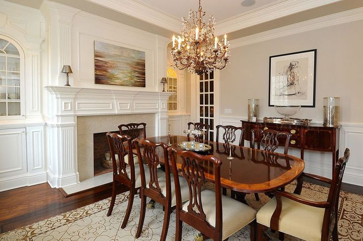 Traditional dining room with fireplace and chandelier