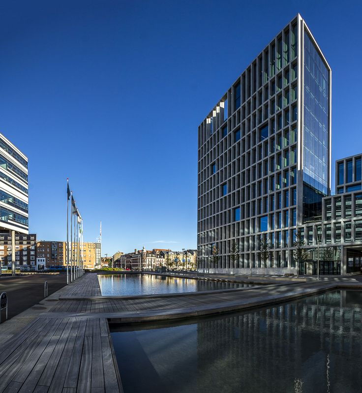 The exterior of the new Bestseller domicile on the harbour of Aarhus. We have delivered the internal doors for the great new architecture. Doors by www.vahle.dk , photos by www.ditlevart.dk