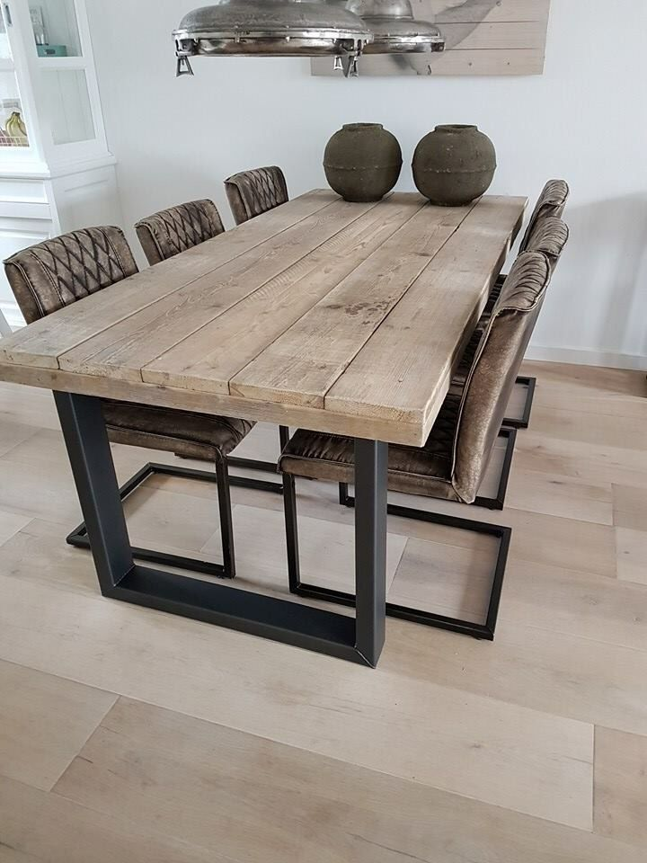 Reclaimed wood table with black metal base. Interior decorating. Home decor