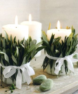 * Chic Provence *: Olive leaves tied with white ribbon around fat white candles