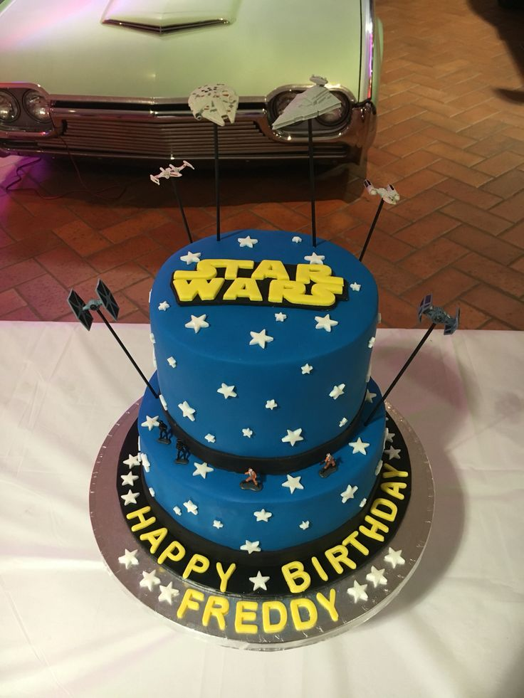 A Star Wars cake for my husbands 40th birthday!! It was a lot of fun to make & and delicious too - bottom tier was white chocolate mud cake with milk chocolate ganache filling & top tier was lemon yoghurt cake with white chocolate ganache, yum!!