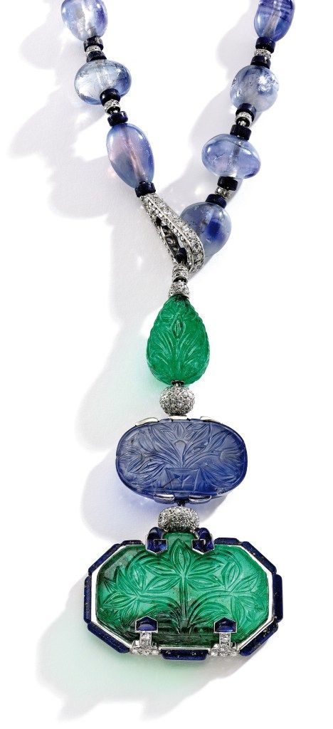 The Baron de Rotschild Necklace: an elegant and rare Platinum, Emerald, Sapphire, Lapis Lazuli and Diamond Pendant-Necklace. Designed by Charles Jacqueau for Cartier Paris, circa 1924.