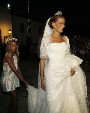 Prince Nikolaos, son of Greece's deposed King Constantine, and his bride Tatiana Blatnik leave Agios Nikolaos church after their wedding ceremony on the island of Spetses, August 25, 2010.