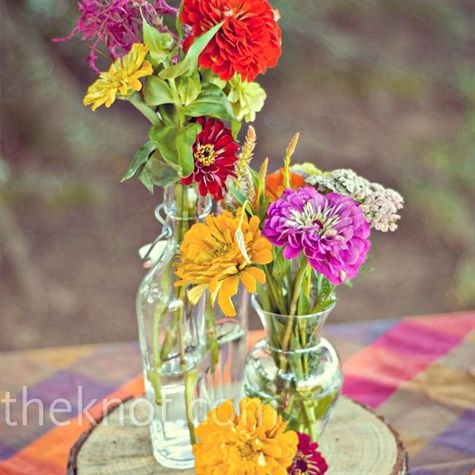 wildflower look in mismatched vases, tree stump base.  Time to start collecting little vases!: Wildflower Centerpieces, Casual Wedding, Wildflowers Centerpieces, Bud Vase, Wildflowers Atop, Colors Wildflowers, Trees Stumps, Colors Flowers, Wild Flowers