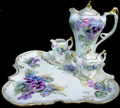 Elegant Victorian tea or chocolate set trimmed with 14K gold and mother of pearl. Beautiful Pansy and violet motif.