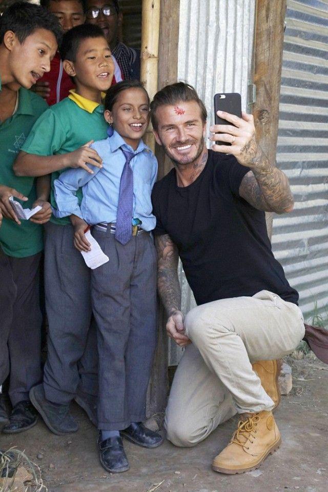 David Beckham wearing  Ralph Lauren Crewneck T-Shirt, Palladium Pampa Cuff WP Lux Waterproof Boots