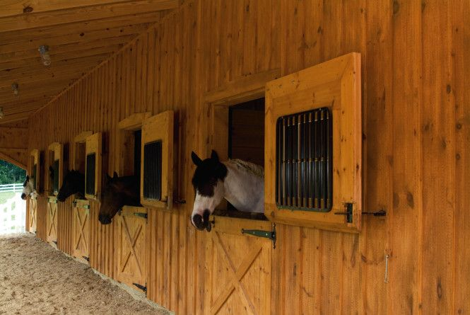 The dutch doors add the perfect touch to this 6 stall for Horse stall door plans