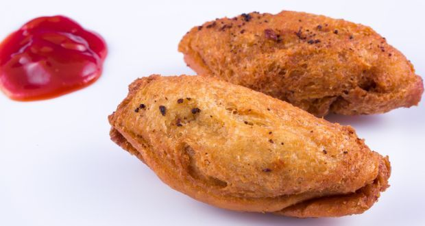 Fish Pakora Recipe - Juicy fish fillets are coated in a spicy batter and fried till a golden perfection. These make a great party starter.