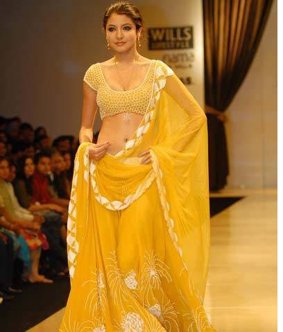 Anushka so pretty in sunny yellow lehenga & choli
