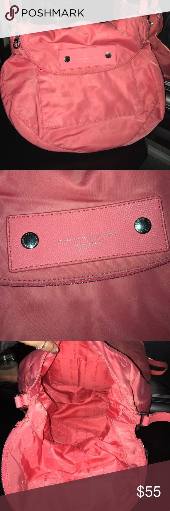 Marc Jacobs Purse Selling my Marc Jacobs pretty pink purse/sachet. This purse has so much room and is perfect for summertime! I am selling because I have too many purses just like it!! Price is negotiable(: Marc Jacobs Bags Satchels