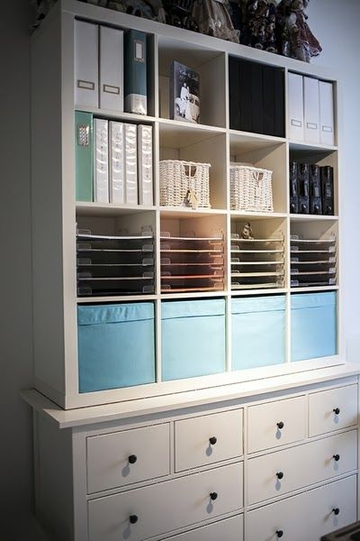 Ikea: Expedit (now Kallax) bookcase sitting on top of Hemmes chest.