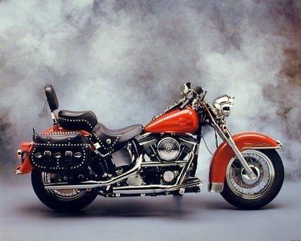 This beautiful wall poster depicts the image of red Harley Davidson vintage motorcycle which will definitely add a new dimension to your home decor. It is a fine pick to turn your room into a connoisseur's living space. Discover the uniqueness of this poster and order today for its durable quality with excellent color accuracy. Enjoy your surroundings!