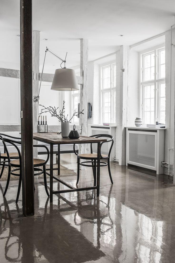 glossy concrete floors, exposed beams + thonet chairs | via rum hemma