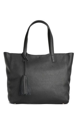 Scandi Tote - black  Available in two neutral shades and embellished with a metallic bronze  stripe and trim details. This tote takes a simple silhouette and makes everyday sophistication effortless.