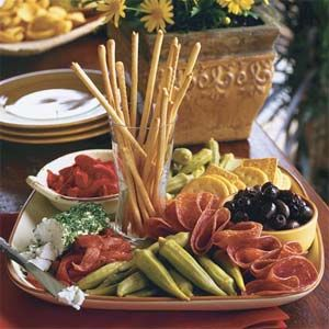 The Barefoot Contessa always serves an Antipasto Platter for a party. Doesn't really require a recipe, as you serve what you like, I just pinned this as inspiration and serving idea.