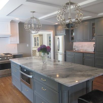 White Fantasy Granite With Grey-Blue Cabinet Design - not loving the lighting fixtures but I love he cabinet color with the marble countertop and brass hardware and drawer pulls