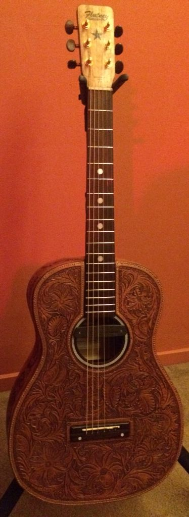 Guitar with hand tooled leather cover. Cover made by John Egenes. Muffles the tone, but the look......!
