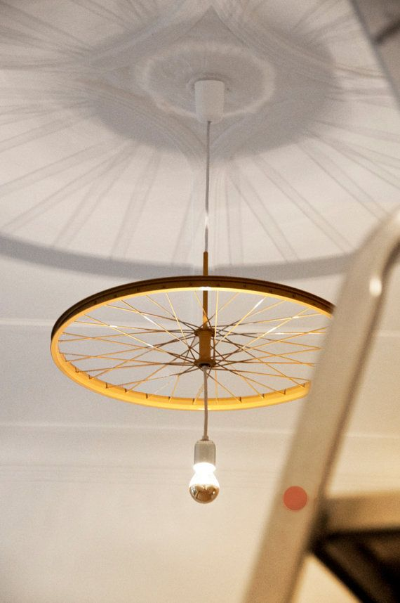 """Pendant Rim ceiling lamp by DLF Productdesign is a combination of dynamic shadows and the sustained demand of our time. It is a pendant made of recycled bicycle rims. The pendant """"Rim Lamp"""" is the third lamp of the lamp-wheel series """"Rim Lamp"""", which is celebrating its debut at the Blickfang exhibition in Stuttgart in 2012 and is awarded with the MINI Interior Design Award 2012. By 'DanieleFerrazzano' on Etsy."""