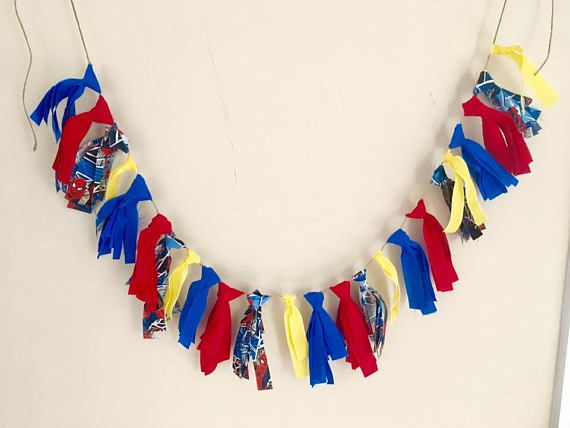 This is a Super Hero themed Fabric Tassel Garland. It is held together with twine. Great for Cake smashes, birthday parties, photography props, decorating for bedrooms, holidays and more! this item is adjustable in length and moves well and is great for using over and over again. There is a plain blue fabric, a plain Red fabric, a superhero theme fabric and a yellow ribbon. 24 tassels in all. Must prepay and will be shipped within 1 business day. I can make custom orders for $20 which…