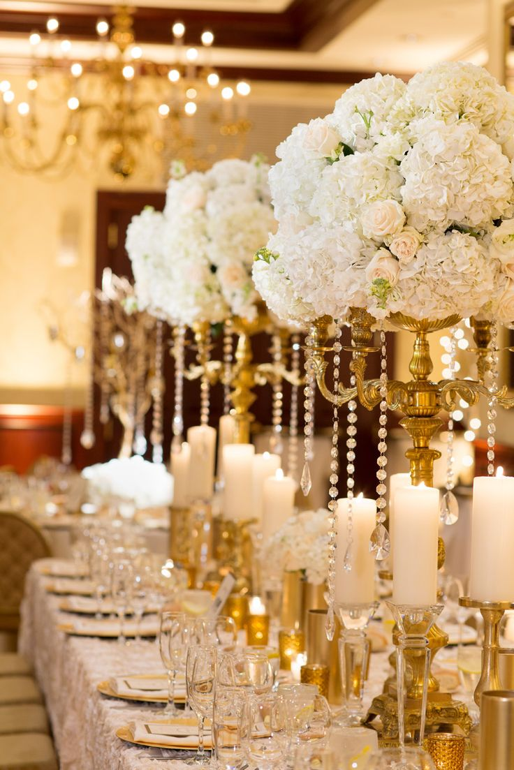 Gold Candelabra Centerpiece With White Roses