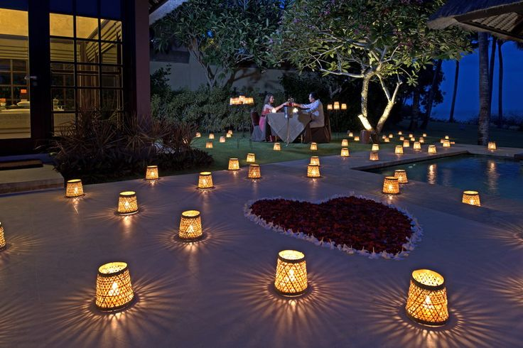 Candle Light Dinner - AYANA's Candle Light Romantic Dinner is served in a Bali luxurious villa aglow with dozens of candles and surrounded by beautiful umbul umbul decorations - Balinese flags, umbrellas and flowers.