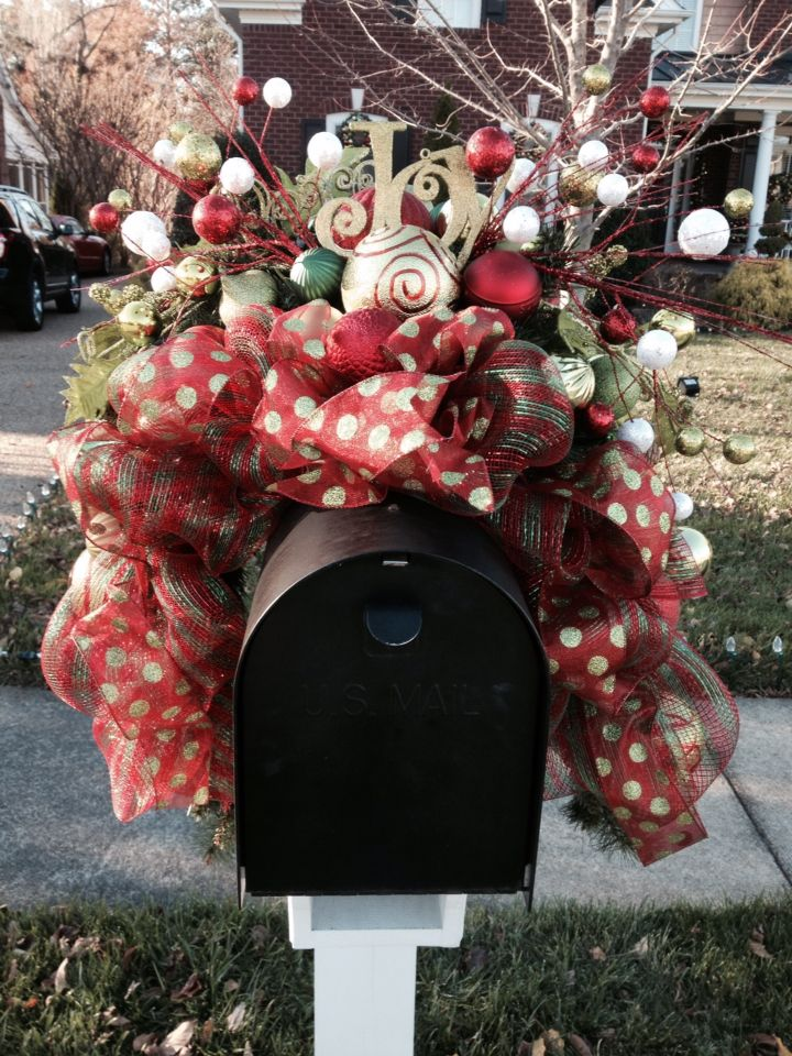 Deco Mesh mailbox swag. Attached to a floral foam saddle, greenery and ornaments.