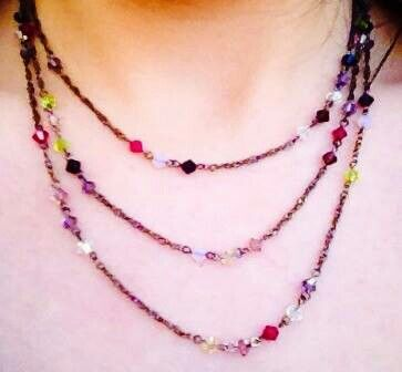 Multihued crystal drops on gunmetal. Several shades pink, purple, green clear and opaque... the black ones are really dark purple
