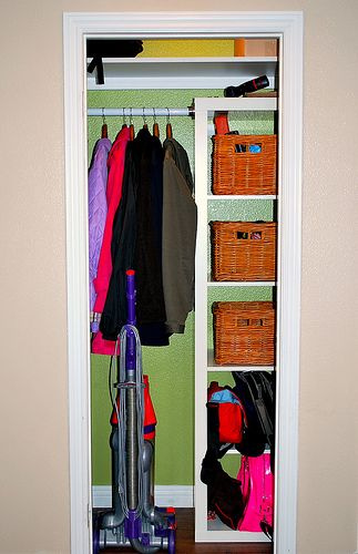 Mudroom closet - expedit shelves from ikea?  or built ins?  Maybe put a couple sets in for storing gloves/hats, summer stuff, and games.  Need a longer coat rack.