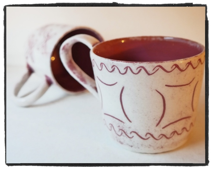 earthenware cup, red clay and white sgraffito for decoration with traditional signs - the spiral