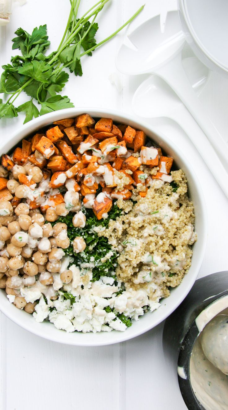 Healthy Kale Salad Bowl with Tahini, Roasted Sweet Potatoes, Quinoa, Feta, and Chickpeas #veggies #healthy #recipe