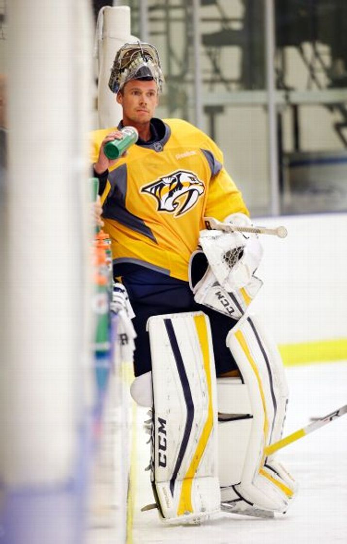 Nashville Predators goalie Pekka Rinne, of Finland, takes a break during a practice at NHL hockey training camp Friday, Sept. 18, 2015, in Nashville, Tenn.