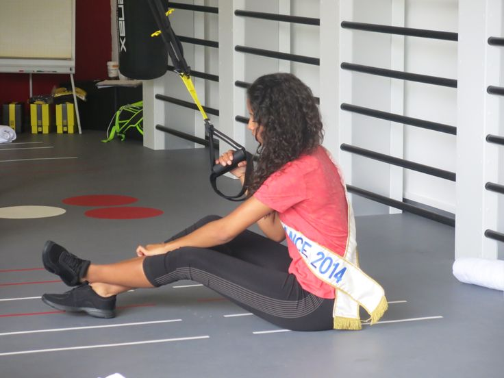 Flora Coquerel Miss France 2014 doing the TRX at Club Med Gym Bercy