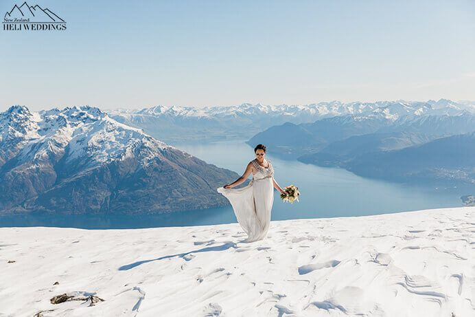 Beautiful spring day, bride stands on The Remarkables Queenstown