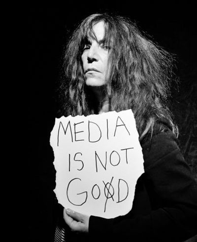 "Patti Smith.  For all of our advances technologically, humanity can't seem to shake's it's blind acceptance of trusting the chosen ""mediator"" between them and the ""god"" of the times.  The media functions like a senile ""Moses"" who stumbles down the mountain with ""gospel"" from on high (the political elite)..."