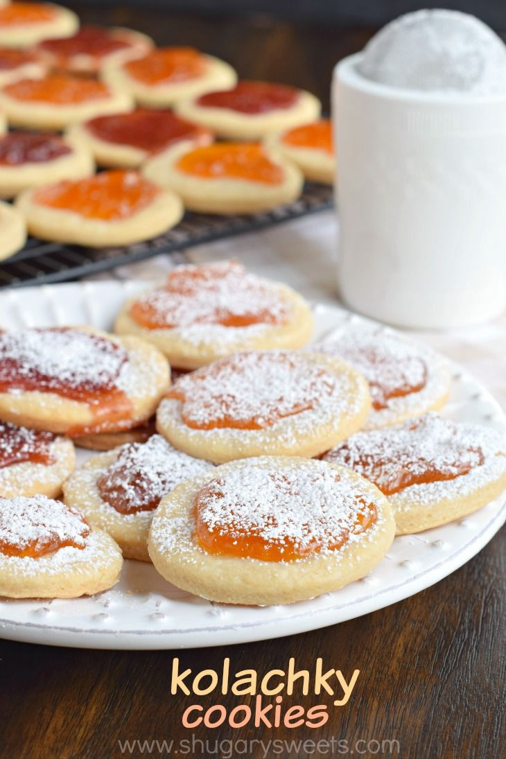 These Kolachky Cookies have a melt in your mouth cookie base and are topped with sweet preserves. Don't forget the extra powdered sugar!