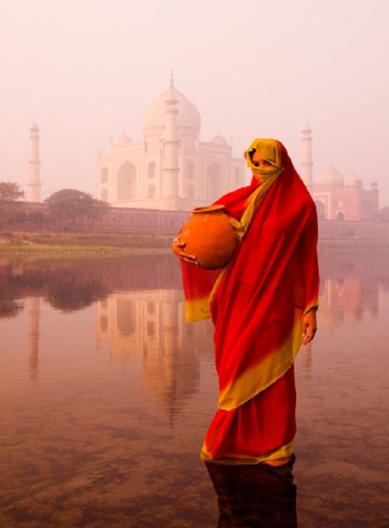 Indian woman wearing a traditional Sari clothing. <3