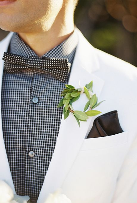 Brides.com: . Your groom will certainly stand out wearing a stylish miniature wreath fashioned from fresh greenery on his jacket.