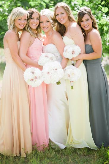 Bridesmaids in Spring colors.