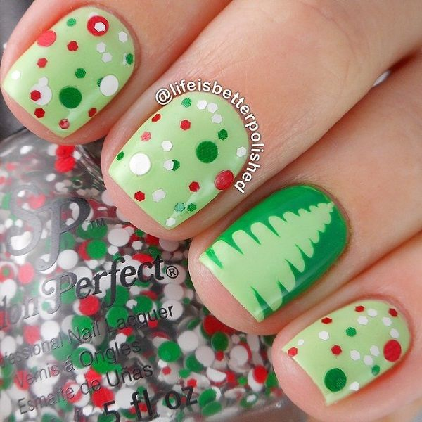 A very cute and adorable Christmas nail art just for you. Paint your nails in dark and light green polish and add colorful polka dots with Christmas tree silhouettes on other nails.